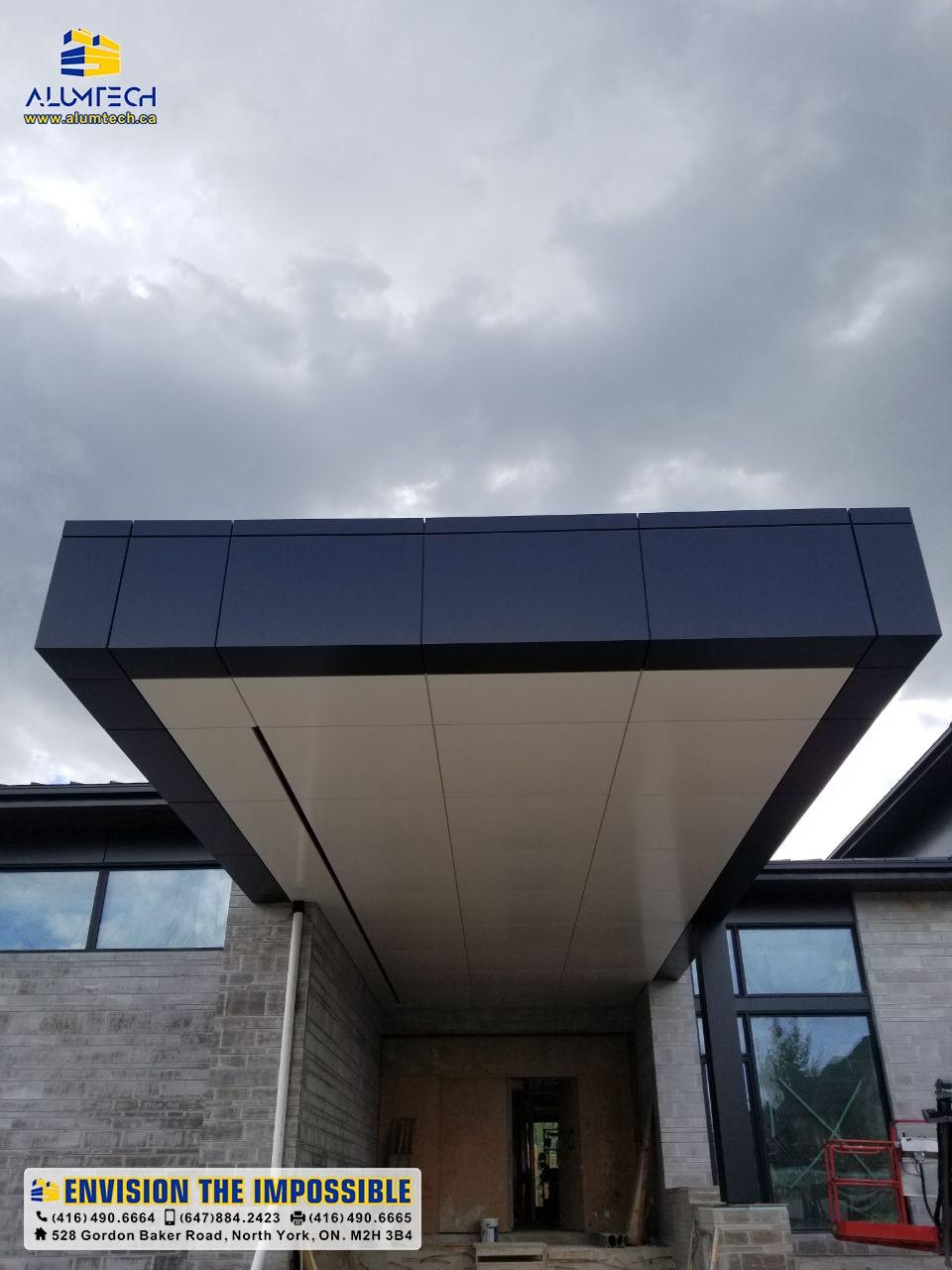 huge veranda, fire-rated black and white acm panels
